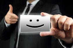 man holding business card with smiley face