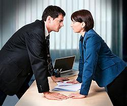 Businessman and businesswoman disagreeing