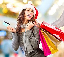 Woman carrying shopping bags at Christmas