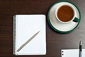 notebook, pen and cup of coffee
