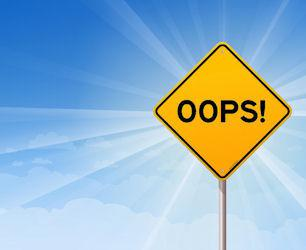 oops sign on blue backcground