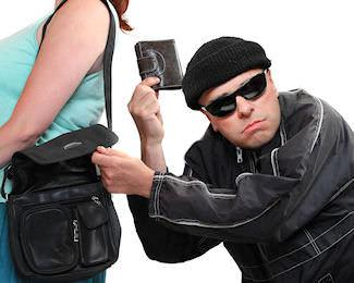 Pickpocket stealing womans wallet